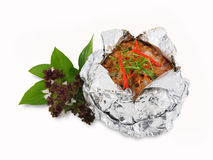 Steamed seafood curry paste cake in foil on white Stock Photography