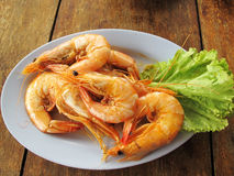 Steamed shrimp. Seafood is any form of sea life regarded as food by humans. Seafood prominently includes fish and shellfish. Shellfish include various species of Royalty Free Stock Photo