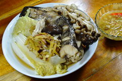 Steamed snake head fish with mushroom and slice ginger dipping spicy soy bean sauce Stock Photos