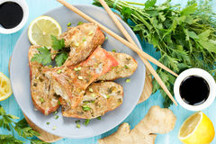 Steamed snapper pacific ocean perch, sea bass, ruby perch with. Soy sauce, lemon, ginger and parsley in Asian style. Healthy cooking stock photography