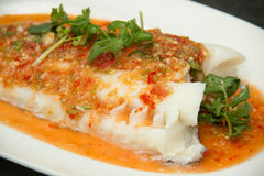 Steamed snow fish with spicy sauce Stock Image