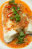 Steamed snow fish with spicy sauce Stock Photo