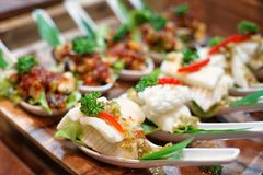 Steamed Squid in Lemon spicy Sauce in cocktail style Royalty Free Stock Photos