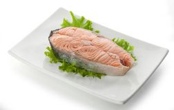 Steak of salmon with fresh lettuce Royalty Free Stock Photography