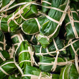 Steamed sticky rice in banana leaf for sale at asian market Stock Photography