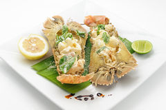 Steamed stone lobster with lemon and lime Royalty Free Stock Photos