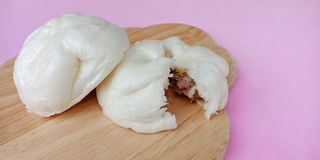 Steamed stuff bun on pink background. stock photography