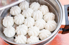 Steamed stuff bun or salapao on green background Royalty Free Stock Photo