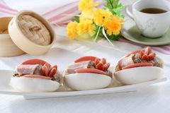 Steamed stuff Bun top with sausages. This Bun is topped with sausages ,bacon and pork Stock Photo