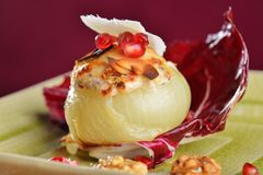 Steamed stuffed onions with goat cheese Royalty Free Stock Photo