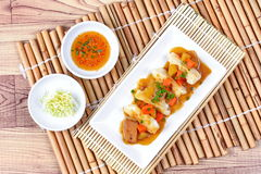 Steamed stuffing flour wrap pork and cabbage topped yellow curry Royalty Free Stock Image
