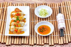 Steamed stuffing flour wrap pork and cabbage topped yellow curry Stock Photos