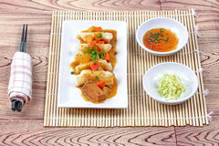 Steamed stuffing flour wrap pork and cabbage topped yellow curry Stock Image