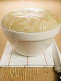 Steamed Suet Pudding in a Pudding Basin. On a Table Stock Photography