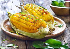 Steamed sweet corn with ingredient herb on wooden plate Stock Image