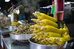 Steamed sweet corns and peanuts. For sale in a stall at Tanjung Aru Beach, Sabah Borneo. Tanjung aru is beach is a famous beach in Kota Kinabalu city Stock Photos