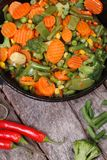 Steamed vegetables in the pan. Vertical top view Stock Photos