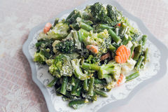 Steamed vegetables with sour cream Stock Photos
