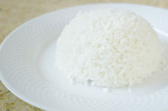 Steamed white rice from Jasmin Rice with fork on the white plate Stock Photos