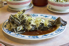 Steamed Whole Fish with Ginger and Scallions Royalty Free Stock Image