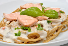 Steamed wild salmon steak with pasta Stock Photography