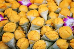 Steamed yellow toddy palm cake with decorative orchid flower, Thai dessert patterns background royalty free stock photo