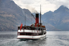 Steamer. Vintage twin screw steamer - symbol of Lake Wakatipu and Queenstown in New Zealand. Rainy weather Stock Images