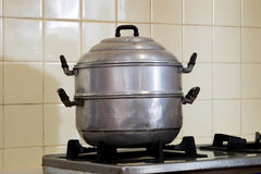 Steamer pot on the stove Royalty Free Stock Image