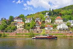 Steamer in the river in front of quay in summer Heidelberg. Steamer in the river and quay of european city in summer Heidelberg Stock Image