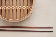 Steamer. Traditional bamboo steamer on bright background Stock Photos