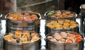 Steamers with Dim Sum Dishes Royalty Free Stock Photos