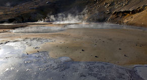 Steaming and boiling mud pool Royalty Free Stock Image