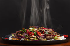 Steaming chicken sizzler royalty free stock photos