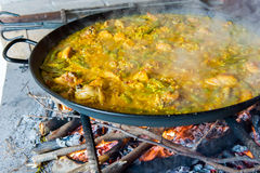 Steaming classic Spanish paella Royalty Free Stock Photography