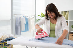 Steaming clothes Royalty Free Stock Photo
