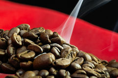 Steaming coffee beans Royalty Free Stock Photo