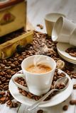 Steaming coffee cup. Cup of hot coffee and coffee beans Stock Photo