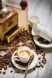 Steaming coffee cup. Cup of hot coffee and coffee beans Royalty Free Stock Photos