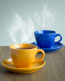 Steaming coffee cup on table Stock Images