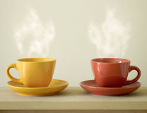 Steaming coffee cup on table Stock Image