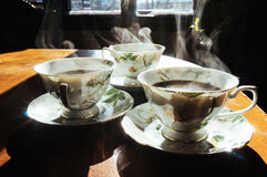 Steaming coffee cups Royalty Free Stock Image