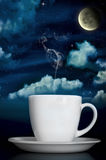 Steaming Coffee Under Moonlight Stock Image