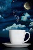 Steaming Coffee Under Moonlight. Dreamy Steaming Coffee Under Moonlight Stock Image