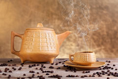 Steaming coffee on wooden table Stock Image