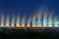 Steaming cooling tower of oil refinery plant. Stock Photo