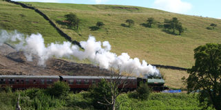 Steaming Cross-Country. A steam train trough the English countryside stock image