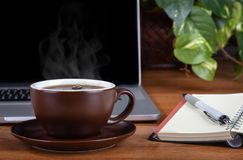 Steaming Cup of Coffee on a Desktop royalty free stock photos