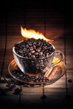 Steaming cup of coffee on fire Royalty Free Stock Image