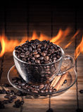 Steaming cup of coffee on fire Royalty Free Stock Images