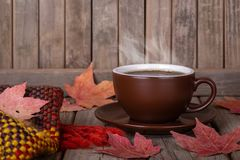 Steaming Cup of Coffee on a Rustic Wooden Background royalty free stock photography